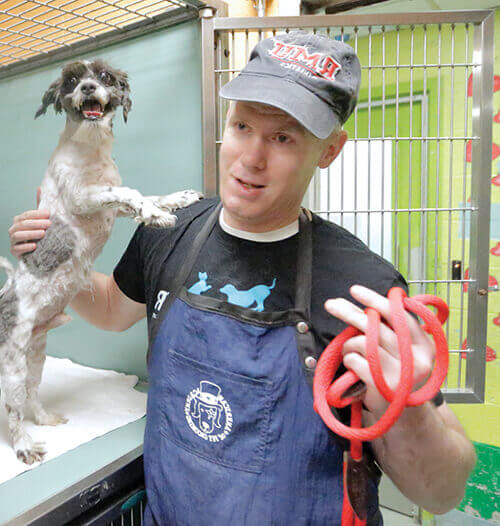 Imhof holding happy rescue dog