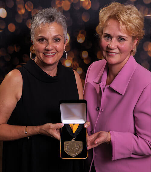 Judy Hudson and Chris Pawlosky with Barkleigh Honors Medal